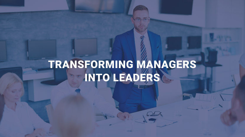 "Man talking with text that says, ""Transforming managers into leaders."""