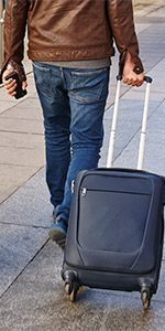 A employee enjoying paid time off with luggage