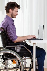 Employee with disabilities working on laptop