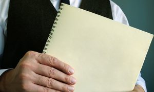 Image of an employer holding a notebook
