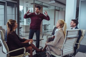 Business owner engaging with employees